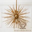 złoty żyrandol gwiazda balck bear house