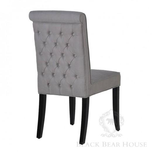 szare tapicerowane krzesło w stylu nowojorskim black bear house