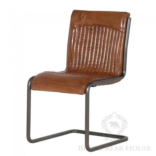 skórzane krzesło na aluminiowej nodze