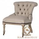 tapicerowany fotel z pikowaniami