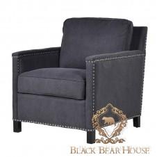 fotel tapicerowany czarną tkaniną