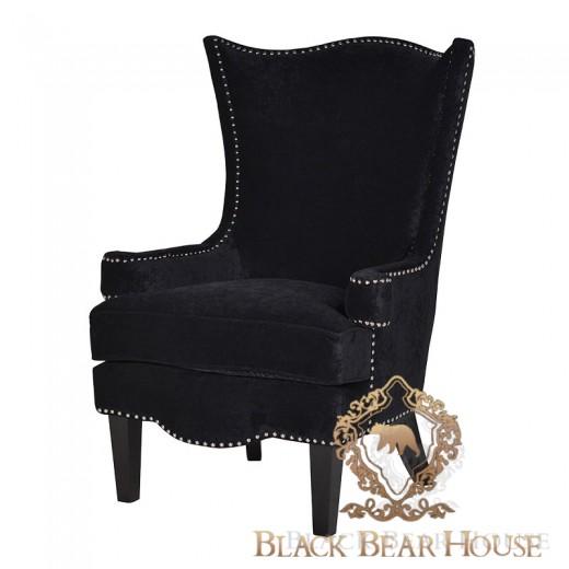 tapicerowany fotel z nitami