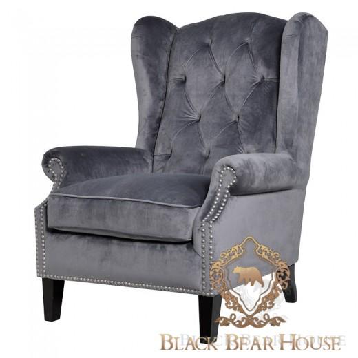 fotel w stylu nowojorskim tapicerowany welurem