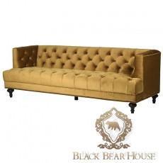pikowana welurowa sofa w kolorze musztardowym black bear house